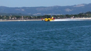 Baiona anchorage...lots of forest fires meant water planes picking up water from bay.